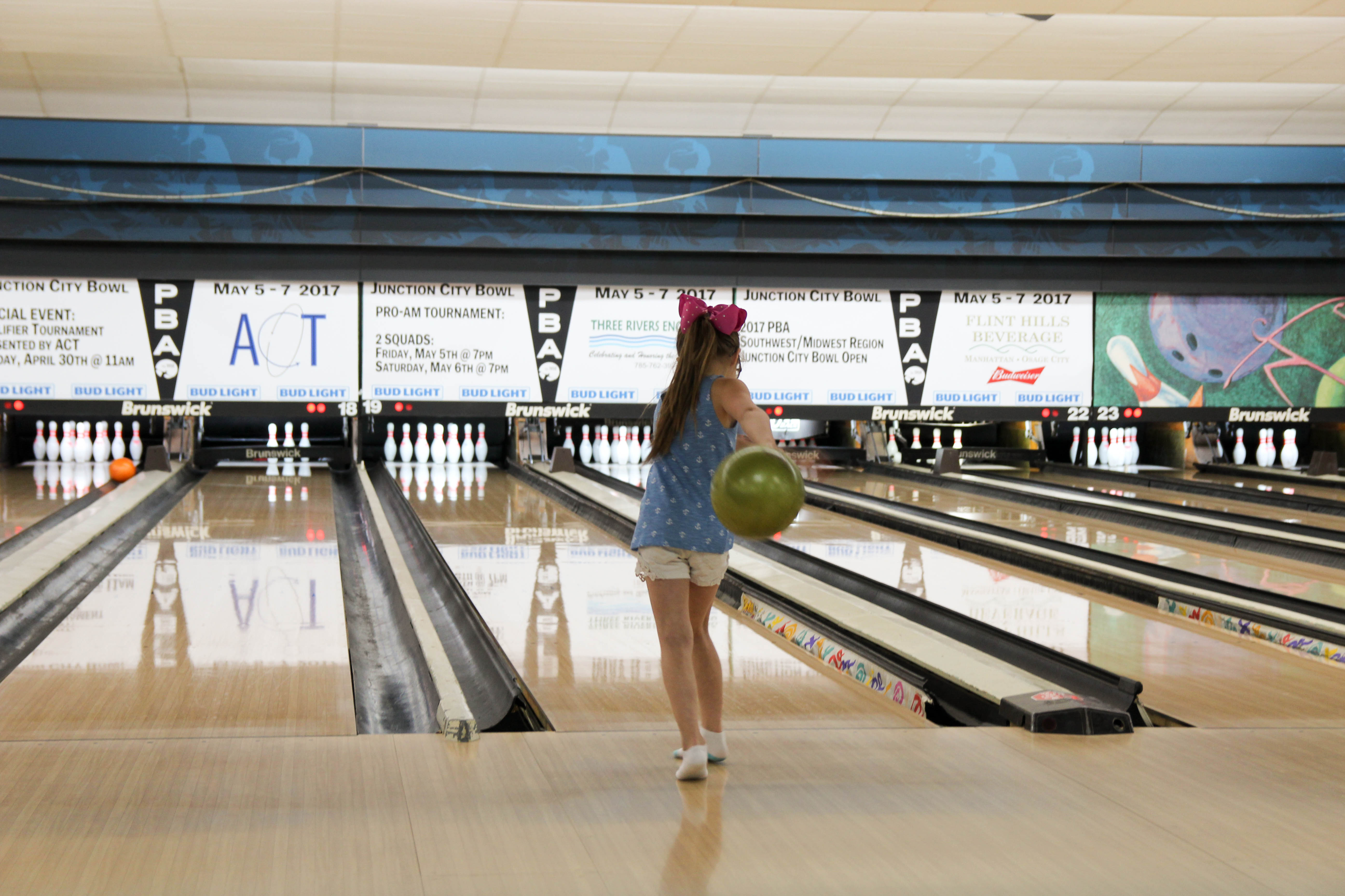 Student bowling at Junction City Bowling Alley