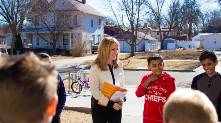 Amy Roether Standing in Front of Children