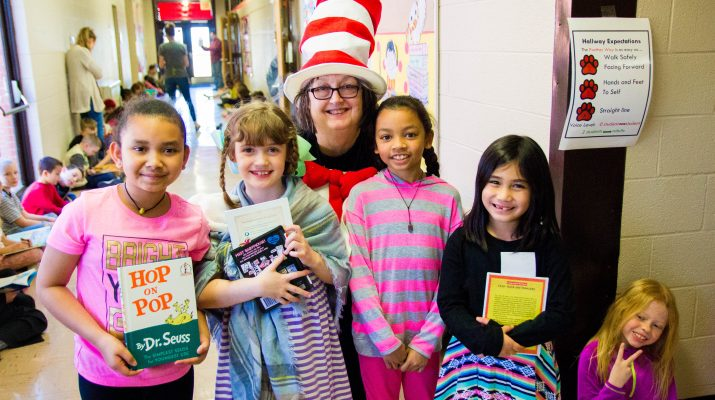 Librarian with Students Dressed as Cat in the Hat Characters