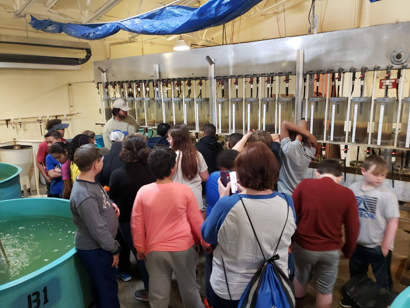 Students in fish breeding facility